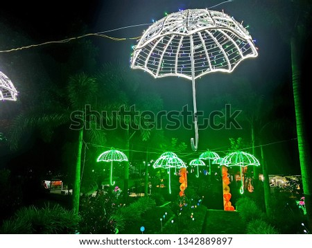 Umbrella lanterns in garden lanterns (taman lampion) at the night in Kaliurang in Yogyakarta.