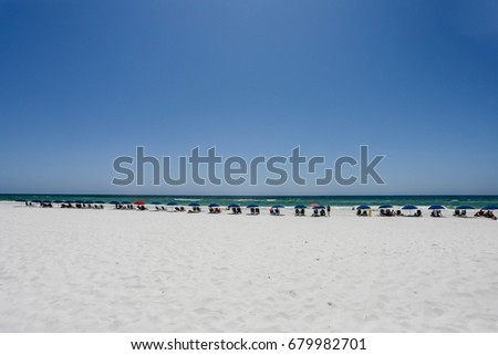 umbrella lined beach in destin florida #679982701