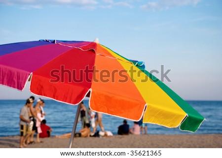 umbrella on the beach - summer leisure - stock photo