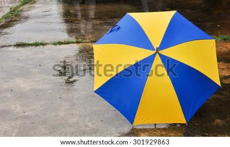 umbrella on the floor wet after rain