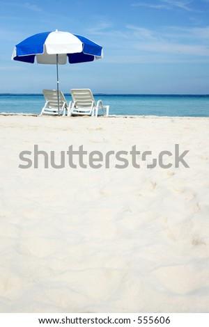 Umbrella on white sand beach