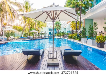 Umbrella pool and chair around beautiful luxury swimming pool in hotel resort - Vintage Light film Filter #373721725