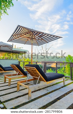 Umbrella pool chair on roof top #281799806