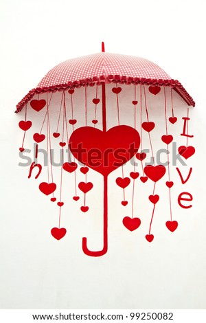 umbrella with heart drops painting on wall