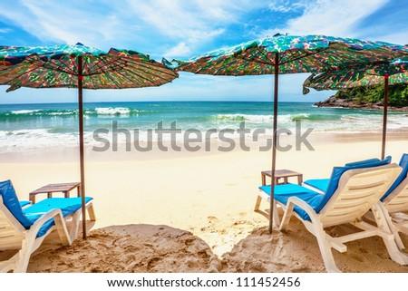Umbrellas at the sand tropical beach. Andaman sea. Phuket island. Kingdom Thailand