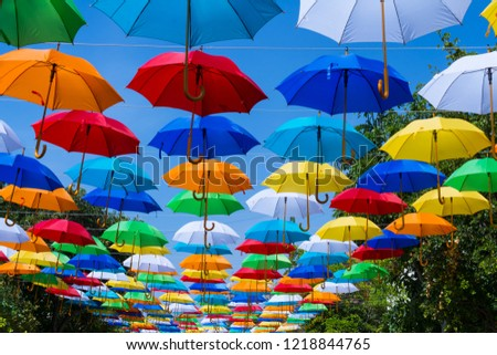 Umbrellas decorate the street. #1218844765