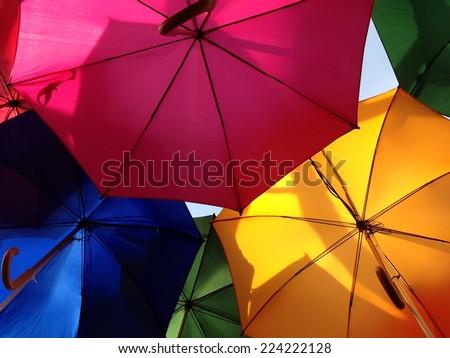 umbrellas rainbow from below