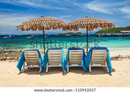 Umbrellas With Beach Chairs  Sea View