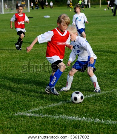external image stock-photo-umea-sweden-june-young-boys-playing-soccer-at-umea-youth-cup-sweden-june-33617002.jpg