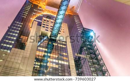 Umeda Sky Building from street level at night in Osaka, Japan. #739603027