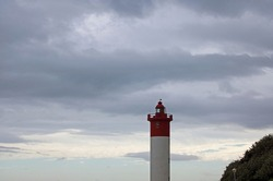 UMHLANGA ROCKS LIGHTHOUSE AGAINST CLOUDY SKY
