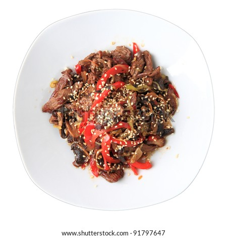umisai guniku - hot beef with mushrooms and sesame seeds on white dish isolated on a white background. top view.