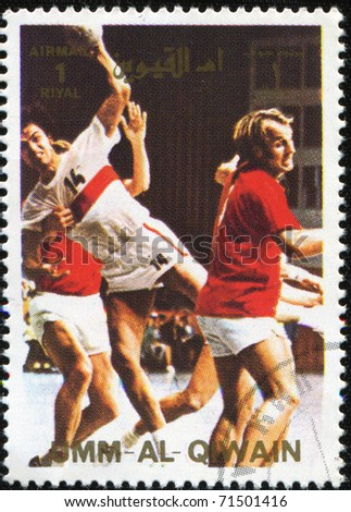UMM AL QIWAIN - CIRCA 1969: a stamp printed in Umm al Qiwain shows basketball players, circa 1969
