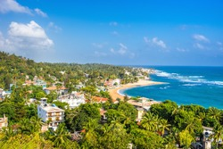 Unawatuna beach at sunny day. Panoramic view from rooftop hotel.