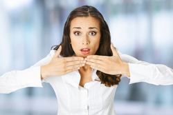 Unbelievable news! Excited surprised, shocked businesswoman, indoors. Business woman covering open mouth by hands, over blurred modern office interior background. scared. fear. fright.