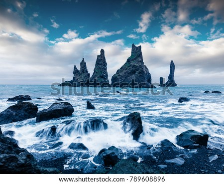 Unbelievable seascape of Reynisdrangar cliffs in the Atlantic ocean. Fantastic summer morning on south Iceland, Vik village location, Europe. Beauty of nature concept background.