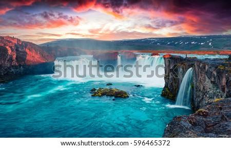 Unbelievable summer morning scene on the Godafoss Waterfall. Colorful sunrise on the on Skjalfandafljot river, Iceland, Europe. Beauty of nature concept background.