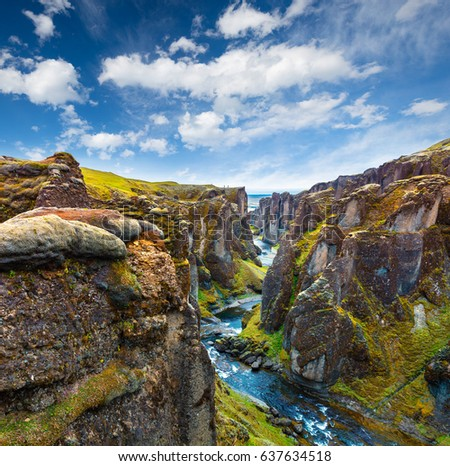 Unbelievable summer view of Fjadrargljufur canyon and river. Spectacular morning scene of the volcanic landscape in South east Iceland, Europe. Beauty of nature concept background.