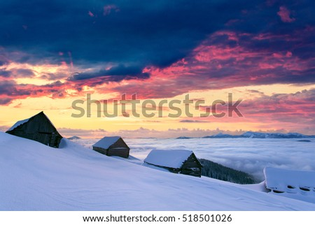 Stock Photo Unbelievable winter view in Carpathian abandoned village. Great outdoor scene in the foggy mountains, Happy New Year celebration concept. Artistic style post processed photo.
