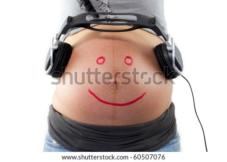Unborn baby listening music in mother's belly