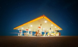 Unbranded Gas station with retail convenience store at night time .
