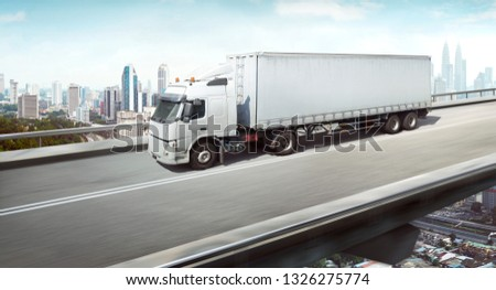 Unbranded generic truck with container on high speed overpass with city skyline , cargo transportation concept. 3D Rendering . Mixed media .