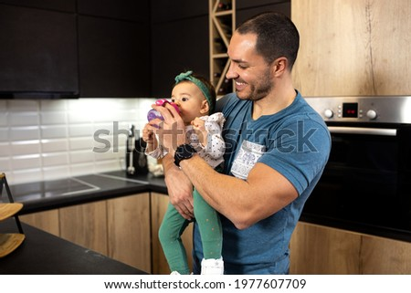 Unbreakable bond between young dad and his baby daughter, happy family concept Stock photo ©