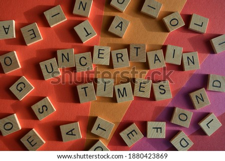 Uncertain Times, words surrounded by random alphabet letters Stock photo ©