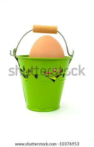 Uncolored egg in green basket, on white background.
