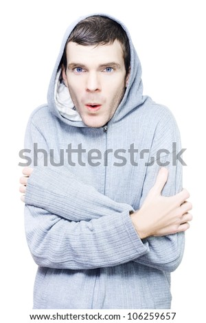 Uncomfortable cold shivering man wearing winter clothing in a low temperature concept isolated on white background