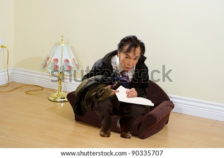 amusing nice living room stock photography image 18909472   Uncomfortable Looking Funny Man , In A Tiny Living Room ...