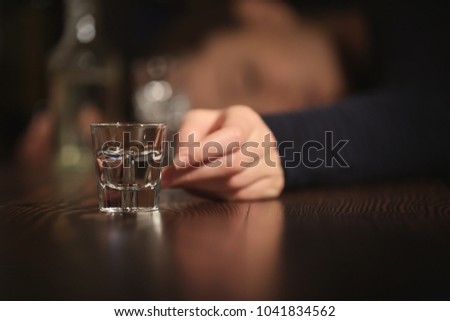 Unconscious drunk woman with glass of drink in bar, closeup. Alcoholism problem Сток-фото ©