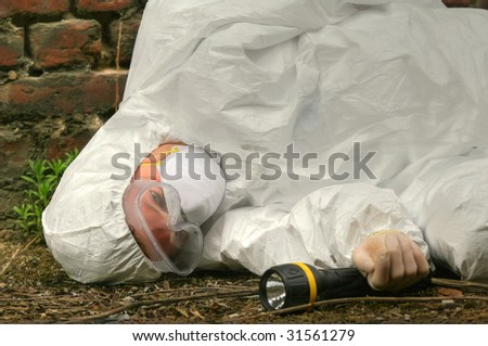 unconscious worker lying on the ground