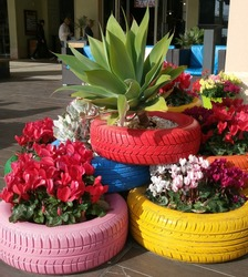 unconventional use of tires, decor and landscape design, creative pots for flowers