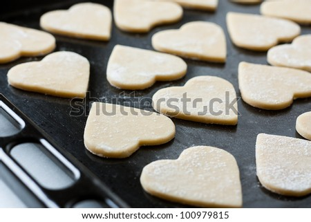Uncooked biscuits on baking tray