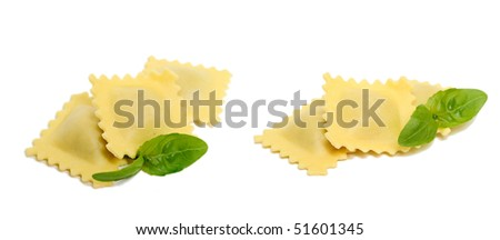 Uncooked homemade Ravioli with basil leaf