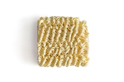 Uncooked instant noodle on white background with clipping path and copy space. Instant noodles is unhealthy food or junk food have high sodium from msg and high calorie but it convenience and cheap.