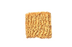 Uncooked instant noodles on a isolated white background. This food is suitable for the Covid-19 pandemic.