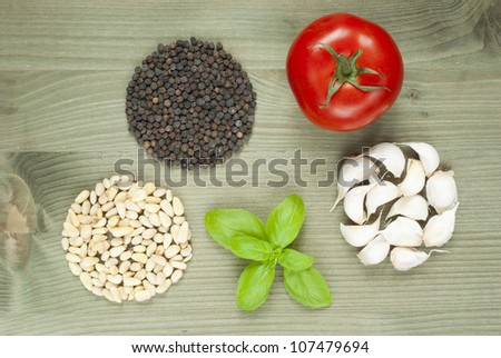 uncooked italian food ingredients on wooden table