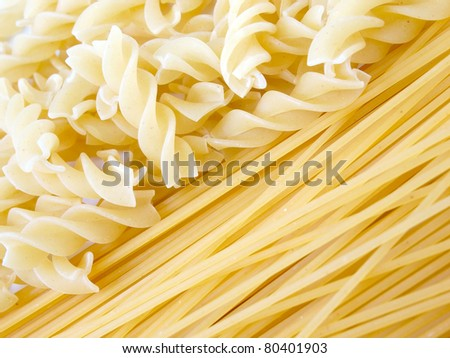 Uncooked Italian pasta Spaghetti and Fusili - stock photo