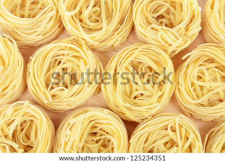 Uncooked pasta spaghetti macaroni as a background