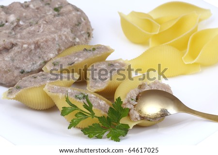Uncooked pasta stuffed with meat ready for cooking