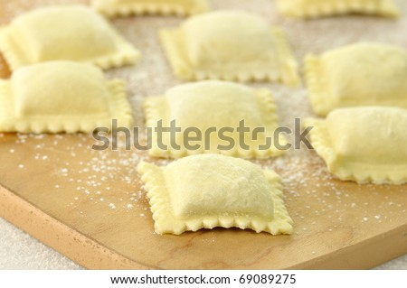 Uncooked Ravioli on a cutting board close up