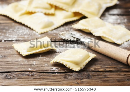 Uncooked ravioli on the wooden table, selective focus #516595348