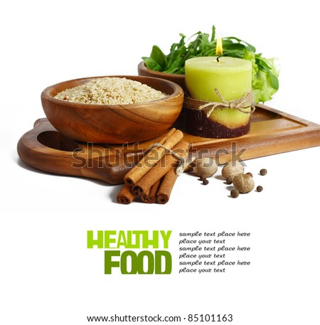 uncooked rice in wooden plate isolated on white background