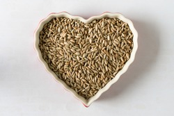 Uncooked Rye Berries in a Heart Shaped Bowl