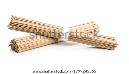 Uncooked soba noodles. Traditional Japanese noodles isolated on white background. Stock fotó ©