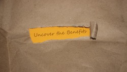 Uncover the benefits. slogan written under torn paper. Business concept.