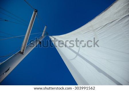 Uncover the wind sail, mast and rigging #303991562