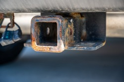 uncovered rusty trailer hitch on the back of a vehicle